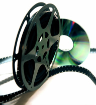 Reel of film next to a silver DVD.