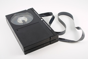 A BetaMax video cassette with tape unraveled.
