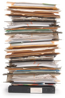 Stack of large files and documents in folders.