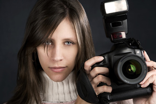 Photographer positions camera with flash.