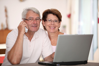Couple enjoys watching video recently shared on social media.